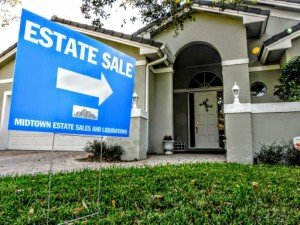 Middle to upper class Florida home with a Blue with white lettering Midtown Liquidators sign on the front lawn